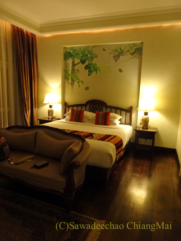 チェンマイにあるピンナカラブティックホテル&スパのベッドルーム
